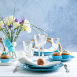 Beautiful Easter table setting with blue plate
