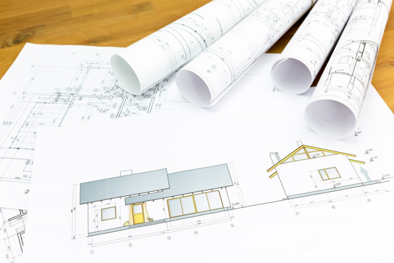 architectural blueprints and construction plans rolls of new home