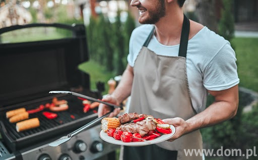 Cropped image of handsome man is making grill barbecue outdoors on the backyard. Bbq party.